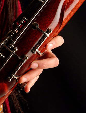 woodwind: Close up to a hand playing bassoon