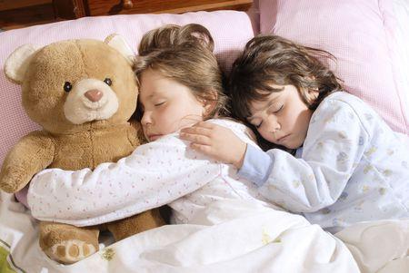 fond: little girls sleeping with a plush bear Stock Photo