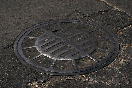 culvert: detail of cilculara iron culvert on the street