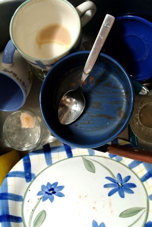 close up of dirty dishes, cups and glasses photo