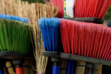 brush in: group of brooms with  long handle brush in green, red,  blue and natural colors