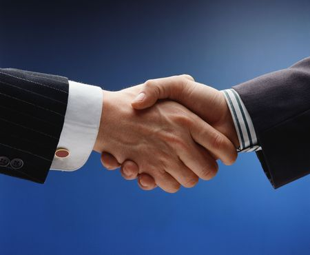 handskakning: business handshake over blue background