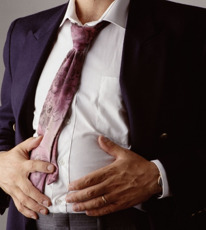 stomach: man indigested after a bussines lunch Stock Photo