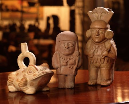 columbian: Three pieces of pre columbian peruvian pottery over a table