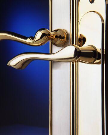 couple of polish brass door handles over blue background photo