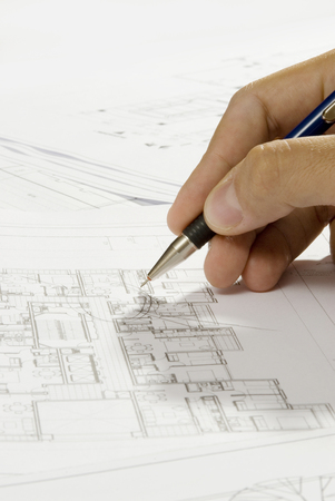 devise: hand writing on a blueprint Stock Photo