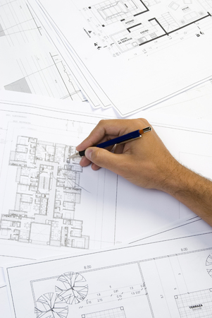 reviewing: hand writing on a blueprint Stock Photo