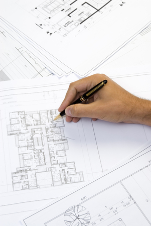 hand writing on a blueprint photo