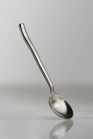 concave: spoon on gray background