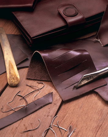 leather wallets maker tools still life Stock Photo