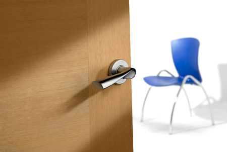 empty keyhole: detail of a an open door whit a luxury lock handle, with blurry blue chair on background Stock Photo
