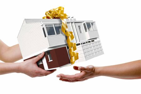 a hand picking a house, all isolated over white  photo