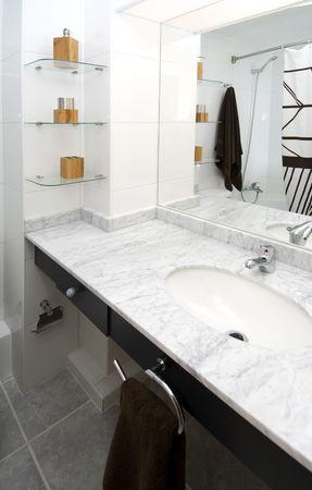 tasteful: a modern bathroom decorated with tasteful