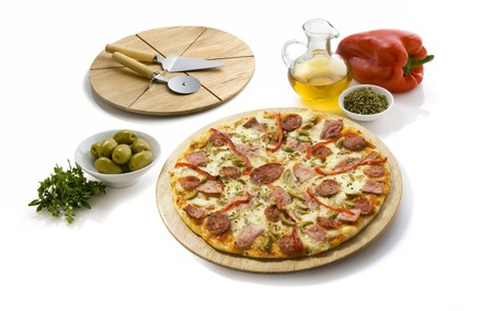 pepperoni and cheese pizza isolated on white, has a cutting table and some ingredients all around photo