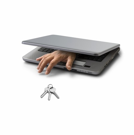 hand emerging from a closed pc laptop trying to steal a key Stock Photo - 3947595