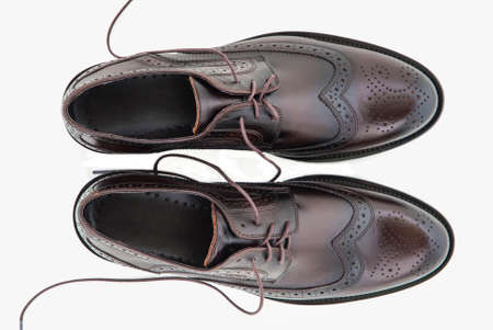 leather shoes: Male fashion with shoes on white top view