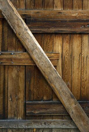 Achtergrond van een oude houten goed versleten schuur deur. Stockfoto