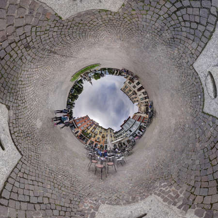 flagging: Panorama village square flagging cloudy sky ball hole around. Shoot in Intra Verbana north of Italy Stock Photo