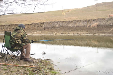 Hobby fishing is an enjoyable one made with fresh water and fishing on the lake. Stock Photo