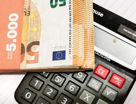 Euro paper money and calculator