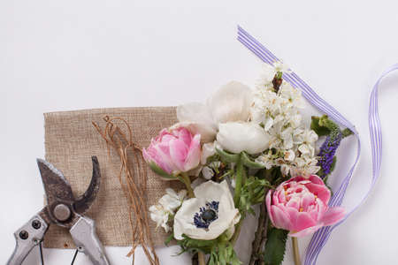 pruning scissors: Pink tulips with ribbon and pruning scissors, prepered to do bouquet
