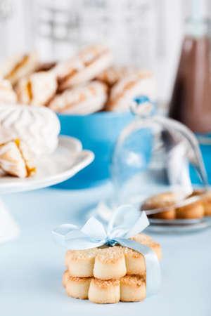 blue box: Cookies, milkshakes, jar of candies, flower and gifts in blue