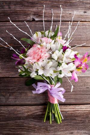 Summer bouquet from gillyflowers and alstroemeria on old wooden background Stock Photo