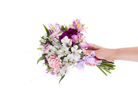 alstroemeria: Hand holding a pink bouquet from gillyflowers and alstroemeria