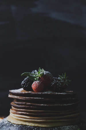 moody background: Pancakes on a rusty pan on dark, moody background