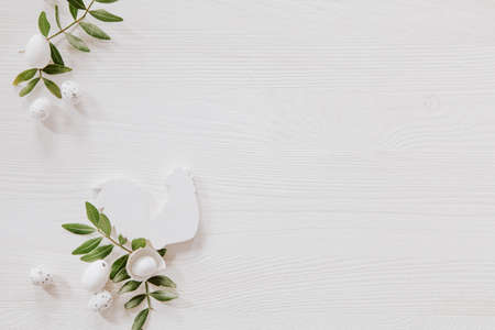 Natural Easter decoration with white wood and green leaves