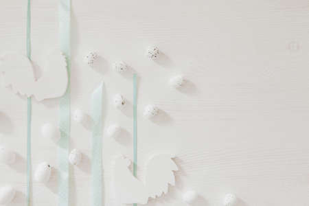 Blue ribbons on white wooden background with little easter eggs and rooster Stock fotó