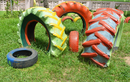 Colorful tires / old wheel tires tractor and tires car painted color in the park for playground