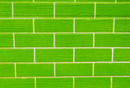 wall green background  brick pattern green wall texture background Stock Photo