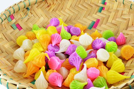 Aalaw candy in basket / colourful candies sweets dessert candy on white background / thai traditional sweet dessert