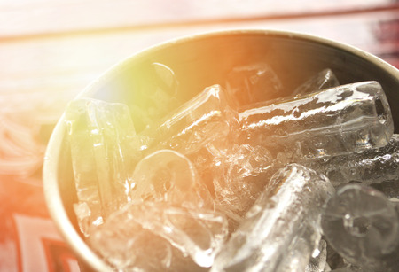 ice cubes in an empty glass  aluminum cup with ice cube for cool drinks water