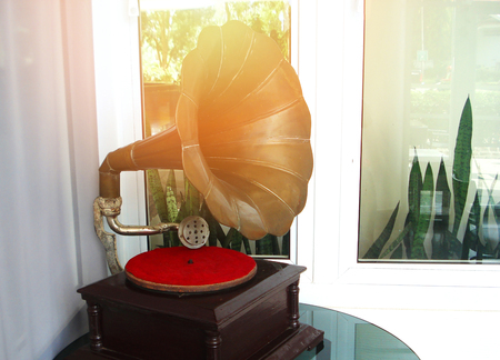 music device / old gramophone with plate or vinyl disk on wooden box