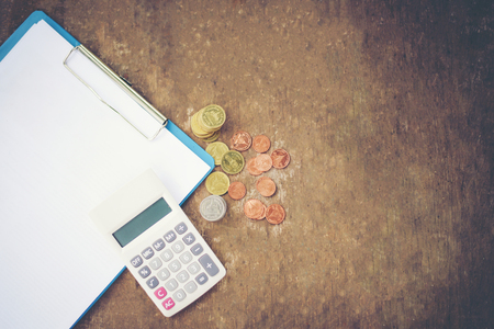 calculator money finance object business accounting concept  counting coins money calculator and notes paper on old wooden background Imagens