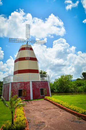 windmill in the garden and blue sky background / Wind turbine 版權商用圖片