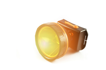 headlamp flashlight isolated With orange lights  black torch light on white background