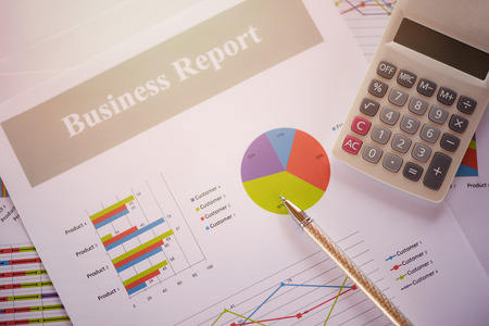 Business report chart preparing graphs calculator concept  Summary report in Statistics circle Pie chart on paper business document financial chart and graph with  pen on top view