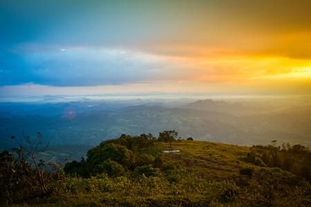 Sunrise on hill mountain nature beautiful sunrise or sunset - landscape colorful sky dramatic cloud hope new day in the morning dawn range mountain sierra hill background Фото со стока