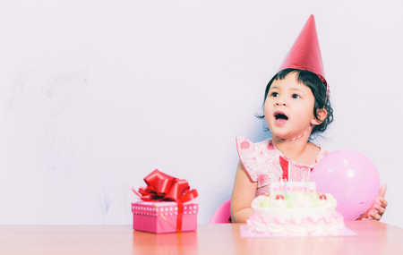 Happy Asia child birthday / Portrait of little pretty girl Happy Birthday Party with gift box and cake