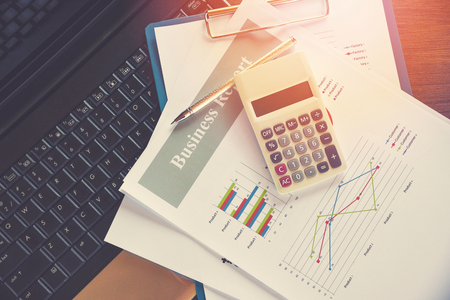 Business report chart preparing graphs calculator on laptop  Summary report in Statistics circle Pie chart on paper business document financial chart and graph with  pen on top view