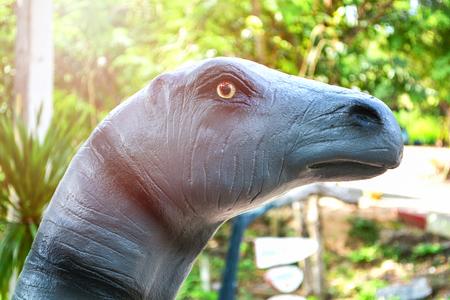 Head of Alamosaurus Dinosaur Statue in garden park