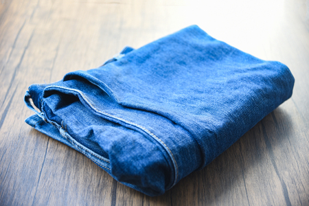 pants folded jeans pattern / Fabric Used of blue jeans on wooden background 免版税图像