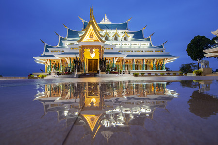 Thai temple beautiful at night twilight blue sky and light reflect on floor - Wat Pa Phu Kon Udon Thani Thailand / Buddhism Temple on hill 版權商用圖片