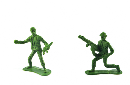 Group of Miniature hold gun toy soldier isolated on white background Archivio Fotografico