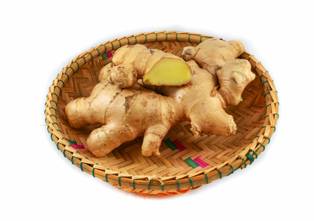 Fresh ginger root in the basket isolated on white background Фото со стока
