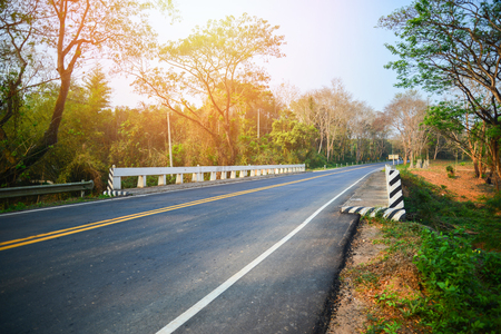 Asphalt road and concrete bridge at countryside in summer 免版税图像