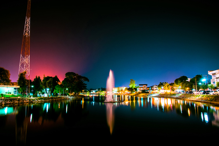 Landscape night lights city and beautiful fountain river in Loei Thailand